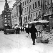 An artist on Nevsky Prospekt in winter in besieged Leningrad