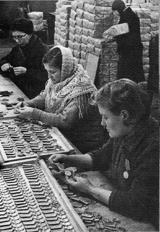 Manufacturing of medals For the Defense of Leningrad at the Leningrad Mint, January 1943