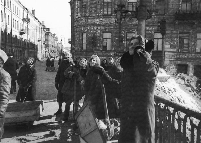 Women are watching the air battle over the city. Spring 1943