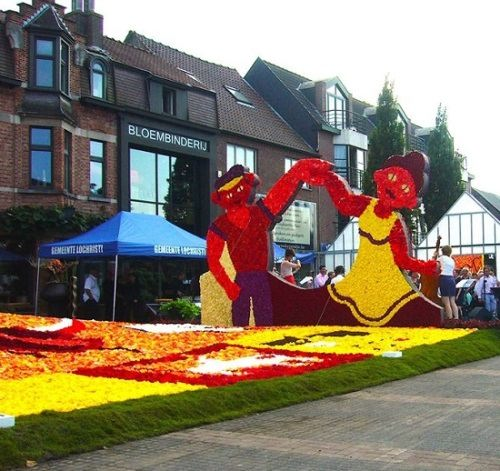 August 2016. Colorful art installation created entirely from begonias. Traditional Lochristi Begonia flower Festival