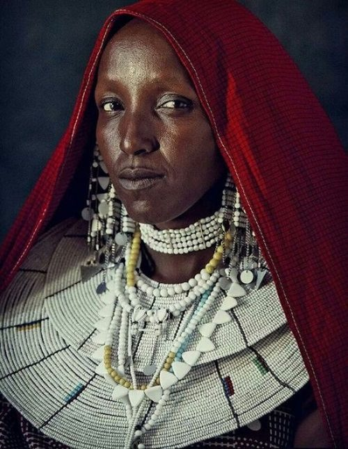 Tribal woman wearing folk clothes. White-red-black color triad mythological meaning