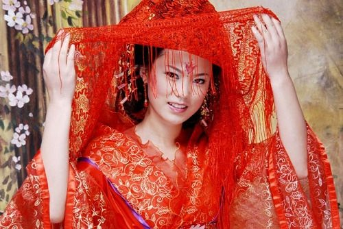 Chinese bride. Red color wedding tradition worldwide